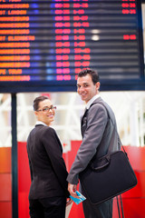 young businesswoman and businessman at  airport