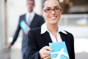businesswoman handing over air ticket at check in counter