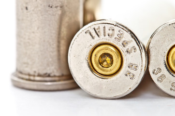 .38 special bullet shells on white background