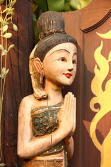 Thai girl doll carving, standing front door