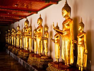 Golden Buddha stands