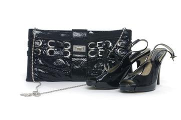 Female shoes and handbag on white