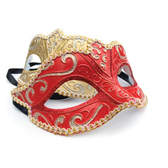 Red and gold masquerade mask on white background