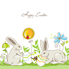 Happy Easter rabbits and eggs on a meadow