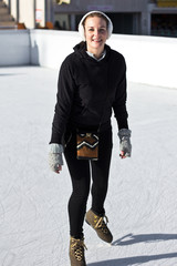 Young Woman Having Fun While Ice Skating