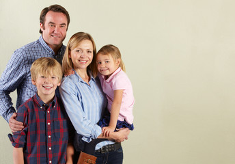 Studio Shot Of Relaxed Family