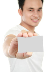 young man showing blank card