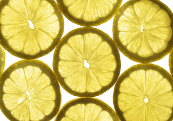 Lemon slices highlighted through the transparent glass
