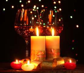 Beautiful candle and glasses of wine
