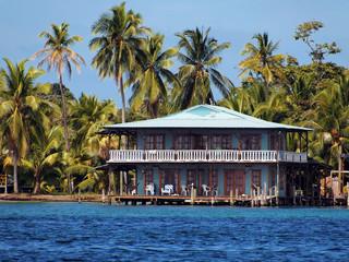 Stilt house and sea