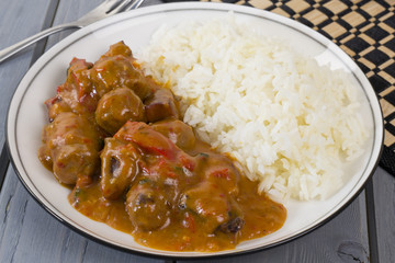 Goulash - Hungarian sausage stew served with white rice