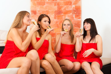 Wellness - women drinking champagne in spa