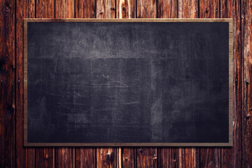 Blackboard on wooden Wall