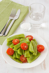 salad green beans and tomato on the plate