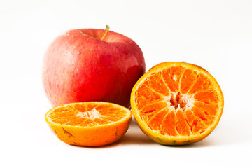 Apple and Ripe oranges on a white background