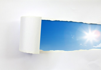 Ripped paper and blue sky