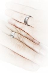 Hands wearing wedding rings