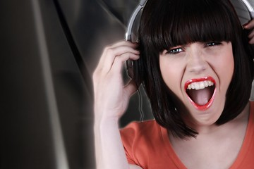 brunette wearing headset shouting