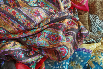 Pile Of Folded Colour Fabrics And Shawls