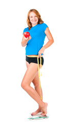 Woman with red apple crouching on scale