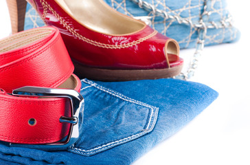 Red belt and shoes, a jeans bag and a skirt
