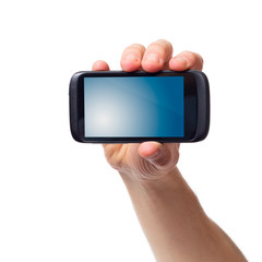 Cell phone (smartphone with touchscreen) in male hand