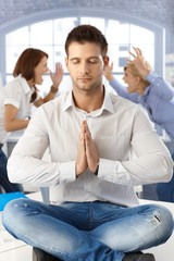Businessman meditating at office