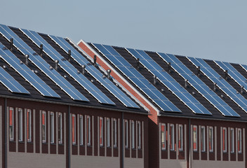 A new row of townhouses with solar panels attached
