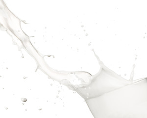 Pouring milk into glass, isolated on white background