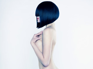 Nude woman with short hairstyle
