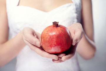 hand with pomegranate