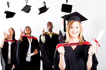 happy female graduate at graduation with classmates