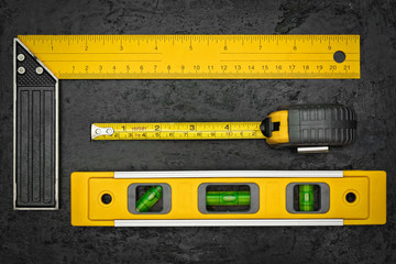 Measuring tools on a black metallic background