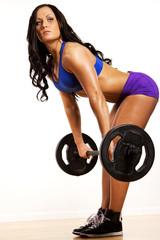 Sportswoman is holding fitness bar