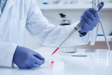 Scientist processing DNA sample in laboratory