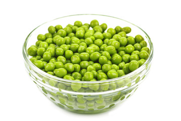 Preserved peas in glasses bowl isolated