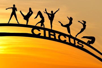 Wall Mural - circus silhouettes and sign in sunset sky