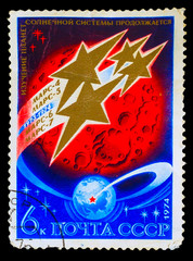 USSR- CIRCA 1974: A stamp printed in USSR, planet Mars and earth