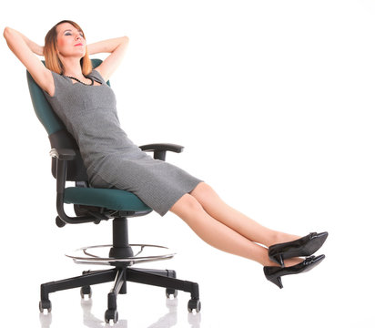 Full length business woman sitting on chair holding clipboard is
