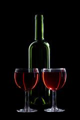 Bottle and glasses on black