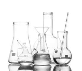 Different laboratory glassware with water and empty with