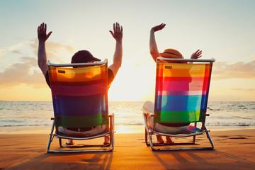 Happy Romantic Couple Enjoying Beautiful Sunset at the Beach