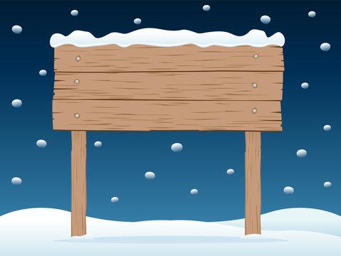 wooden signboard in snowy night