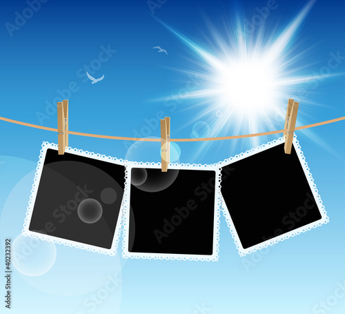 Wall mural Hanging Pictures on blue sky background. Vector illustration.