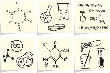 Chemistry and biology icons and formulas on yellow memo sticks