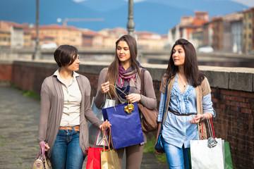 Beautiful Young Women Waliking in the City with Shopping Bags