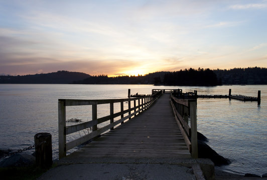 sunset over wooden pier in Anmore ,British Coloumbia