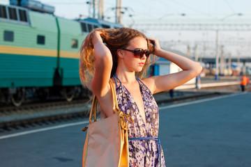 Woman waiting train on the platform