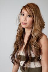 Hispanic woman with long hair, looking at the camera
