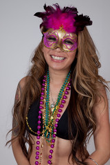 Hispanic woman with party mask and beads